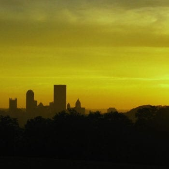 a green sunrise over pittsburgh pa as hope for CBD products medical benefits dawns